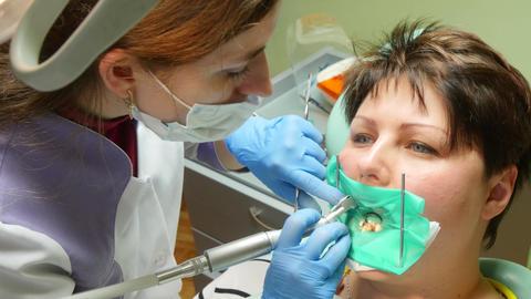 Woman Receiving A Dental Treatment 4k Footage