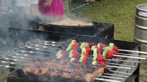 Preparing pilau outdoors, roasting kebab barbecue on brazier Footage