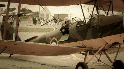 Vintage biplane on ground, airport stylized for World War 2 Footage