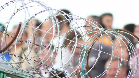 Barbed wire with people on background Footage