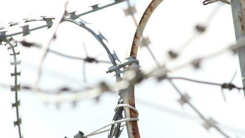 Rack focus of barbed wire at daytime, spikes and wires Footage