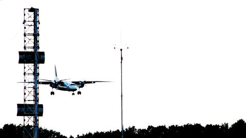 Aircraft landing silhouette at dusk, airplane lands at airport Footage