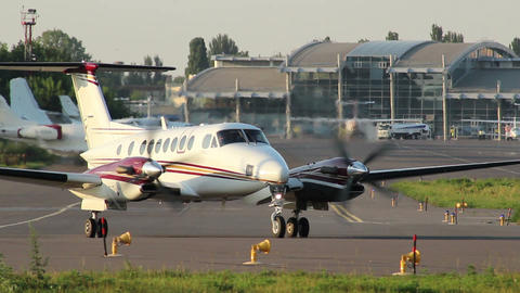 Charter jet with two propellers turning steering for take-off Footage