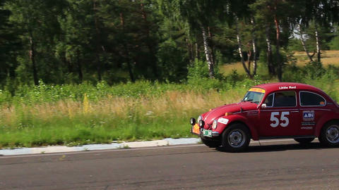 Legendary Volkswagen Beetle in vintage sport cars racing rally. Red colored Footage