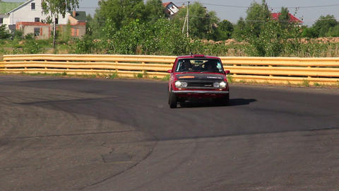 Rare vintage auto Datsun P510 driving over the village. Peking to Paris rally Footage