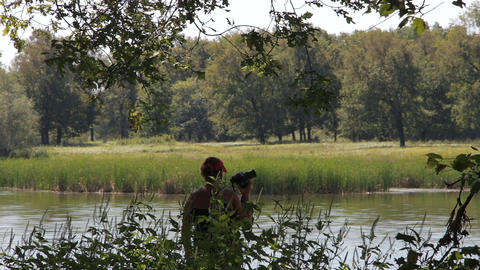 Woman photographing nature Footage