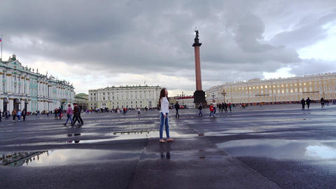 Tourist girl gaze around Palace Square, stand against Alexander Column Footage