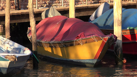 Rowboat Floating In River At Pier Live Action