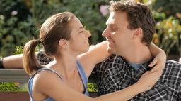 First date romantic couple girlfriend kisses boyfriend gazes lovingly Footage