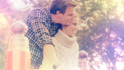 Beautiful happy young couple in love romantically cuddle - color graded footage Footage