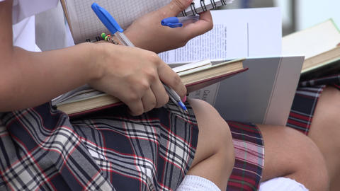 School Girls Writing In Notebooks Footage