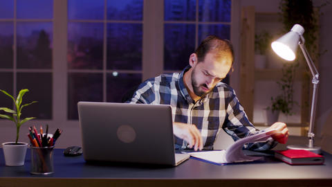 Caucasian businessman signing documents in home office Live Action