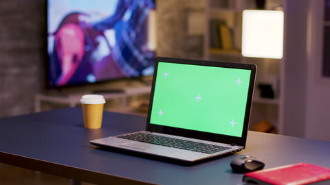 Desktop computer with green screen on home office Live Action