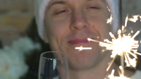 Slow Motion Happy New Year Celebrating Handsome Young Man Holding Sparkles Live Action