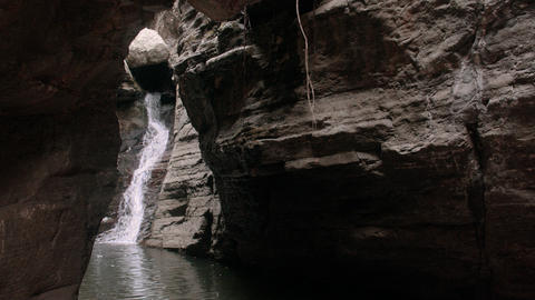 Waterfall in the rocky mountains, Waterfall stream tumbling over large rocks in forest Live Action