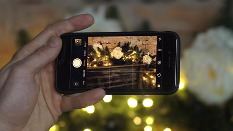 Young Man Shooting Video By Smartphone At The Holiday Party. Closeup Live Action