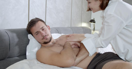 Uninterested boyfriend with annoyed face, girlfriend is… Stock Video Footage