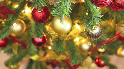 Close up looping stop motion animation of Christmas lights blinking on Christmas tree Animation