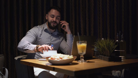 Happy, smiling bearded businessman talking on phone, happy of the deal he made Live Action