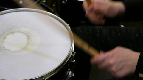 Young child plays drums on drumset Live Action