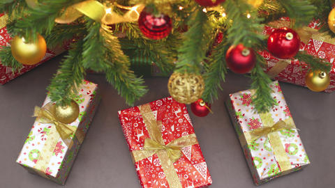 Christmas presents moving under the beautiful Christmas tree Animation