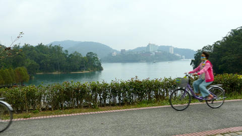 SUN MOON LAKE, TAIWAN - OCTOBER 26, 2019: Cyclists riding around at Sun Moon Live Action