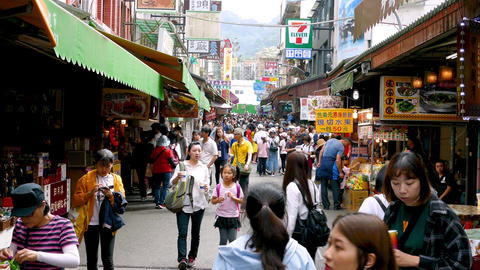 SUN MOON LAKE, TAIWAN - OCTOBER 26, 2019: Tourists shopping in street market Live Action