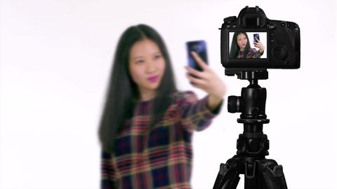 Asian teenager taking selfie from behind camera vlogger concept Live影片