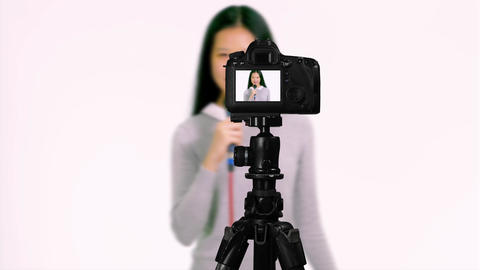 Asian teenager presenting with microphone from behind camera vlogger concept Live Action