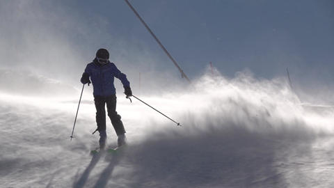 Skier Makes Turns in a Blizzard. Slow Motion Live Action