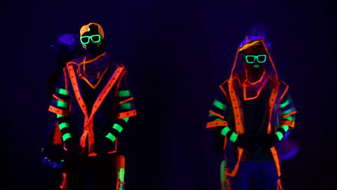 Dance group in neon costumes Live Action