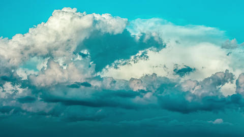 CLOUDS TIME LAPSE, BUILDING MOTION CLOUD WITH BLUE SKY. Puffy fluffy white clouds blue sky time Live Action