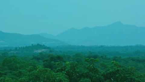 Aerial view of mountains covered rain forest, trees. Mountain landscape on tropical island with Live Action