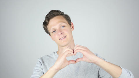 Handmade Heart Sign, Young Man Expressing Love, Isolated Gesture Footage