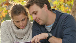 Couple using a tablet PC to purchase item via online shopping website app Live Action