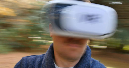 Conceptual VR man in VR headset goggles looking arounf virtual world Footage