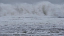 Big ocean sea waves crashing on coastal rocks during storm Footage