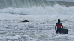 NSW, AUSTRALIA - JUNE 2016: bodyboarder surfer massive waves stormy sea Footage