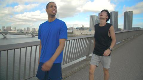 International friends Japanese man Running in Tokyo slow motion Footage