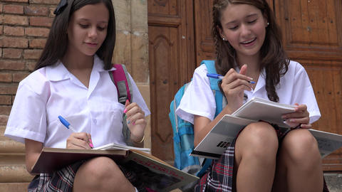 Teen Girls Writing At School Live Action