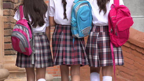 School Girls Walking With Backpacks Footage