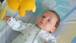 Portrait Of A Baby With Toy Mobile Footage