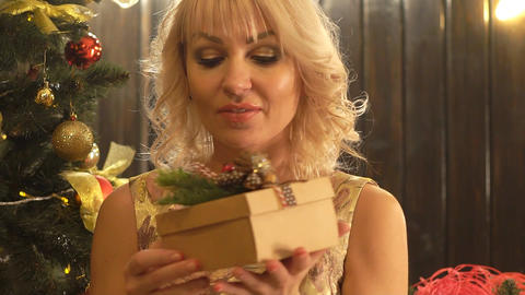 Present Box In The Hands Of A Woman. Happy New Year, Merry Christmas, Present Live Action