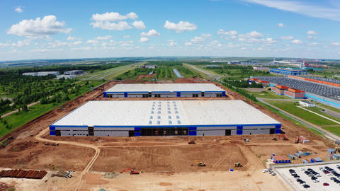 construction site of huge modern warehouse aerial panorama Live Action