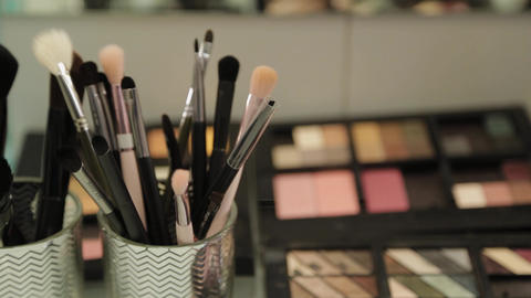 Professional makeup artist tools on a table in a beauty salon Live Action
