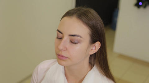 Beautiful girl in a beauty salon awaits procedure Live Action