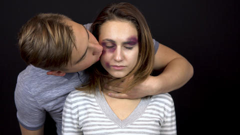 A young man strokes and kisses a young woman. A woman with bruises on her face Live Action