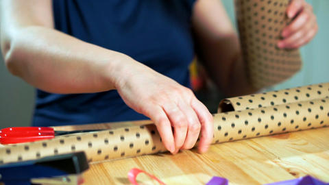 Close-up of women's hands holding craft wrapping paper Live Action