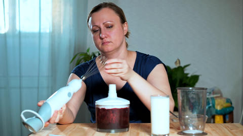 The concept of healthy eating. A woman prepares a blender Live Action