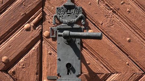 Antique wooden door with decorative metal handle Live Action